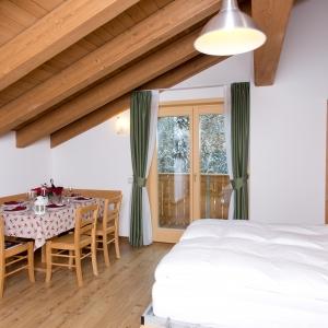 Residence Civetta zona giorno con divano-letto aperto