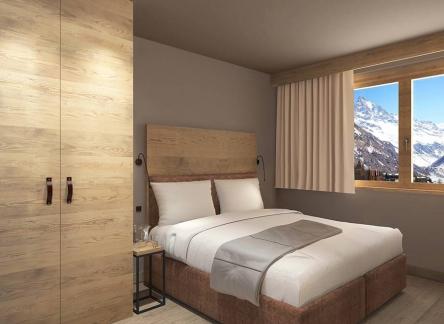 vacanceole-zinal-chambre-lit-double-min